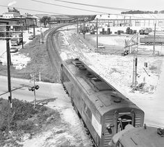 Amtrak Floridian southbound Saint Petersburg section, powered by two EMD E-units, heads west as seen from the U.S. 92 Highway overpass at Auburndale, Florida, mid 1970's | by alcomike43