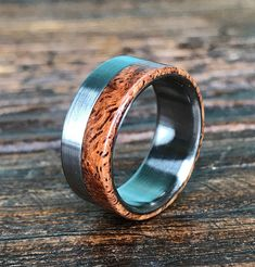 This handmade titanium ring is just stunning. It is overlaid with a gorgeous piece of afzelia burl wood. Afzelia is native to subtropical Africa and Asia and has a unique and interesting grain. This custom made ring can be engraved on the inside (twenty character limit, please. Also, limit your engraving to letters, numbers, and simple punctuation.) Not looking for a titanium wedding ring? This titanium and afzelia burl wood ring makes an excellent every day ring as well as an anniversary…