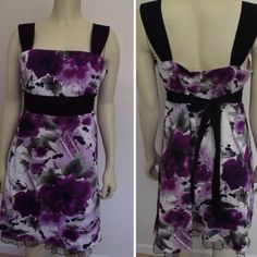 """Floral """"Painted"""" Dress This purple&sage floral """"painted"""" brush stroke dress has a black sash that ties around back. As well as black sleeveless straps and a black tulle underneath that barely shows on the bottom. The zipper goes about half way down the back and is very subtle. Barley worn. iz Dresses"""