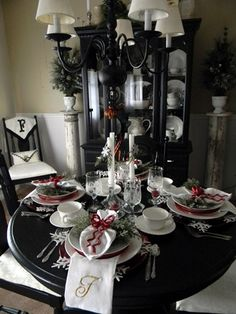 I like the black table and hutch - the tall stands on either side of the cabinet and of course the Christmas Table Setting
