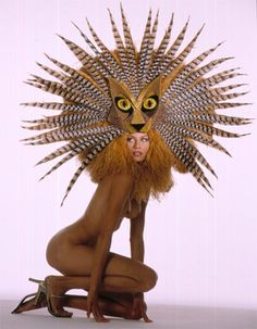 "2002 Bob Mackie - From the Broadway Collection. Inspired by ""The Lion King"". An elaborate butterscotch ostrich and pheasant feather lioness headdress and mask, with wire frame."