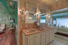 1960 Houston time capsule house — Foil wallpaper galore, you know I luv it --- Retro Renovation --- French Provincial bathroom cabinets