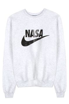 VFILES LIGHT GREY AND BLACK NASA CREWNECK SWEATSHIRT Light grey cotton Champion sweatshirt featuring black NASA logo on front and upper back. SIZE & FIT Unisex sizing. Small––Width: 18.5 inches. Height: 26 inches Medium––Width: 21 inches. Height: 26.5 inches Large––Width: 22.5 inches. Height: 27.5 inchesXLarge––Width: 25.5 inches. Height: 27.5 inches Width is measured at 1 inch under underarm seam. Height is measured from the top to bottom of the piece's backside. VFILES + NASA VFILES has…