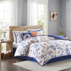 Brighten up your master bedroom with the Madison Park Makena Collection. This unique digitized print features a floral pattern in bold blue and shades of coral that coordinates back to three decorative pillows with embroidery and fabric manipulation techniques to complete this look.