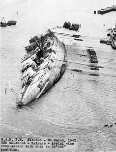 The USS Oklahoma is pulled upright after capsizing due to damage during the Japanese attack on Pearl Harbor Dec 7, 1941. 21 massive GE DC motors were anchored to the shore and cables strung to the ship. It took three months to pull the ship upright. It was beached, patched up and sold for scrap, but while being towed to the US, it developed a leak. Despite the efforts of the salvors, the ship settled and finally, after many hours, rolled over and sank.