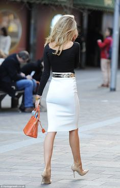Black blouse with a scoop neckline in the back with a belted high waist white pencil skirt and nude heels. Simple with style. All neutrals.