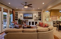 uncentered fireplace made to look centered...it works! Traditional Family Room by Cindy Smetana Interiors