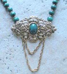 Single strand of malachite beads with vintage brooch by d3tennis, $40.00
