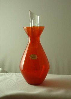 $302.70 in 2013   Red Orange Erickson Glass Liqueur Decanter Air Trap Stopper