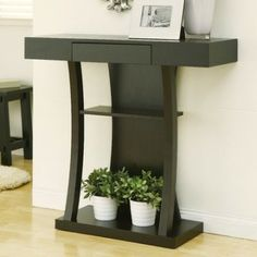 The curved and clean lines of the Console Table are wonderfully complemented with round and decorated edges of the mirror. The table Lamp accents the appeal to bring about a contemporary and inviting look into your entryway.