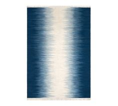 Le tapis Lilus. Avec son motif traditionnel Ikat modernisé en bleu et beige, il apportera couleur et chaleur à votre intérieur. Tissé à plat