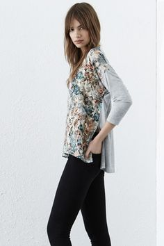 #WAREHOUSEWISHLIST This lightweight jersey tee features a round neck, cropped sleeves and silky front panel with a floral and Aztec print. Length of top, from shoulder seam to hem, 62cm approx.. Height of model shown: 5ft 10 inches/178cm. Model wears: UK size 10.
