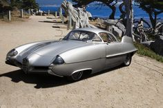 "1953 Alfa Romeo BAT 5 Concept Car. Concepts created through a collaboration between Alfa, Italdesign, and Bertone ""BAT"". They were far more than just stylistic exercises. They were intended to explore the aerodynamic effects of fins on automobiles. One of the advantages was enhanced stability at high speed. BATs could do over 125 mph thanks to the advanced aerodynamics. The exciting finned design reflected the world's growing obsession with outer space and speed."
