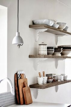 More lovely wooden shelves..with white braces...very interesting!