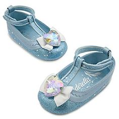 Disney Cinderella Costume Shoes for Baby | Disney StoreCinderella Costume Shoes for Baby - Your fairytale princess will attend the ball in our Cinderella costume shoes. Adorned with a faceted heart-shaped jewel, these glamorous shoes sparkle with an allover glitter pattern and textured non-slip soles for a night of dancing.