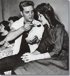 Elvis at his 25th birthday, sharing cake with girlfriend Priscilla Beaulieu - Friday, January 8, 1960. Taken at the Sportheim [means sports hall], Hauptstraße 102, Bad Nauheim, Germany.