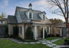 'Hanover' Isler Homes, general contractors, Dallas, TX. I am in love with this stone cottage with a slate roof and a walled front yard...