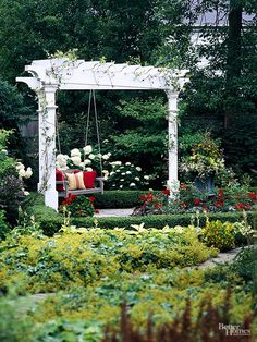 A pergola doesn't have to be large to make a statement. Tucked amid a well-manicured formal garden, this triangular pergola is a striking focal point--small but nicely detailed, with a classic white painted finish. The swinging bench makes it all the more inviting and versatile.