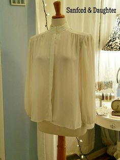 Check out this item in my Etsy shop https://www.etsy.com/listing/290261545/cream-colored-dreamy-vintage-blouse