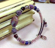 This Memory Wire bracelet is done in shades of purple. It has a beautiful oval focal bead of Magnesite dyed in rich hues of purple, gold, and Memory Wire Jewelry, Memory Wire Bracelets, Gemstone Bracelets, Bangle Bracelets, Bracelet Fil, Bracelet Making, Jewelry Making, Wire Wrapped Earrings, Wire Earrings