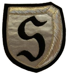 """JG-26 Jagdgeschwader Schlageter.  This was a Luftwaffe fighter squadron that operated mainly in Western Europe but also against Russia during WWII. It was named after WWI veteran Albert Leo Schlageter, hence the 'S' insignia. This is a black """"S"""" embroidered on a silver fabric and edged with silver wire bullion. Size: 3"""" x 3 1/2"""" approx."""