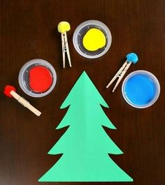 Create a Christmas Tree craft using a simple painting with pom poms technique. It's a great toddler craft. Create a Christmas Tree craft using a simple painting with pom poms technique. It's a great toddler craft. Christmas Tree Painting, Christmas Tree Crafts, Christmas Projects, Christmas Themes, Santa Crafts, Xmas Tree, Christmas Crafts For Kindergarteners, Simple Christmas, Christmas Christmas