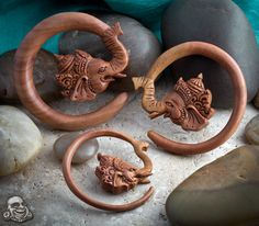 Saba wood Ganesha. $69.95 for a size 0 pair       http://www.bodyartforms.com/productdetails.asp?keywords=ganesha&button=Search&RecordDisplay=&Filter=Yes&ProductID=9155&index=2