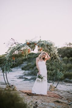 oceanic wedding inspiration -round floral arbour with wild native flowers