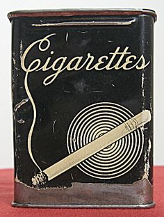 Black & white cigarette tin from the 1930s. Push-open top.