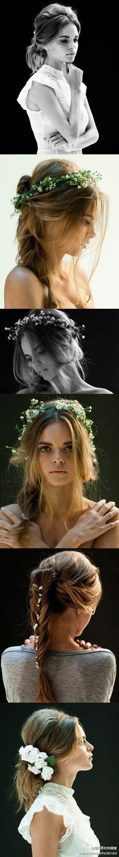 She wears flowers in her hair.