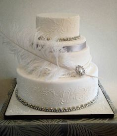Vintage Silver/White Wedding Cake with feather, sugar pearls & brooch -WedLuxe Magazine