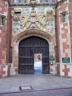 St John's College Gates, University of Cambridge, England. The small 'door' (shown open) is called a wicket gate and can be opened separately from the larger wooden gates when necessary.