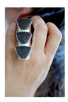 Beautiful Creature Ring by dollybirddesign on Etsy ~ This is fashioned with actual dinasur bones and this artist makes several unusual pieces!