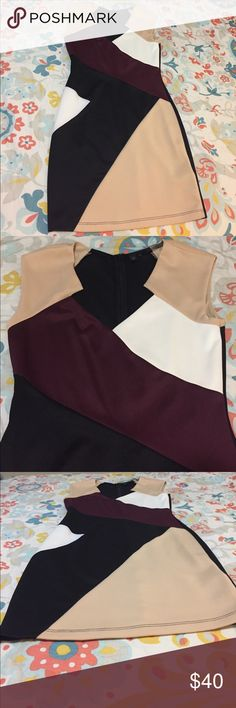 Guess Dress Black, tan, maroon and white Guess dress,  above knee length. Size medium. Lightly used only used three times. Guess Dresses Midi