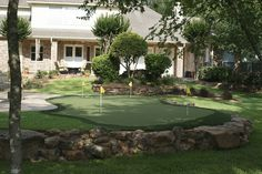 This is another great backyard green. My advice is don't blow you budget on an enormous putting surface. Invest in the beauty of a backyard green by incorporating a beautiful landscape that surrounds the green. It's nice to be able to get the 40+ footers, but seriously, how often do they make the difference? It's inside of 20' that make the difference. C'mon we all know that! Next artifical grass project: Wrigley Field. I could call it Wrigley North. Or Wrigley field will call it mini-me.