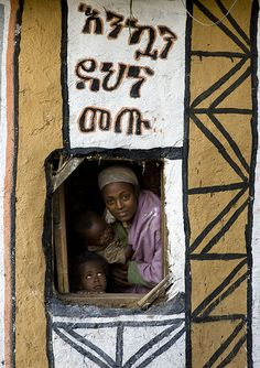 Mother and children in a tukul, Ethiopia  •  Eric Lafforgue