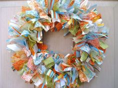 Kick off your summer decorating with this handcrafted Ribbon Fabric Wreath! Hang in a sunny kitchen, brighten up a guestroom, office/study door or display on a well protected entryway or covered porch all season long!   Summer Wreaths, Summer Door Wreath, Wreath for Summer, Summer Door Decor, Fabric Wreath, Ribbon Wreath, Rag Wreath for Front Door, Orange, Blue, Green, Teal, Etsy Wreaths