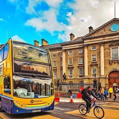 Another busy day in Dublin as both a bus and cyclist pass Trinity College. A fantastic photo by @me.tiryaki
