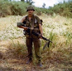 US soldier with an M60 machinegun - Vietnam War my weapon of choice.The goverment bought the M-60 on a contract at almost 6000.00$ each for the vietnam war.