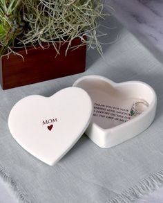This lovely jewelry box would be a perfect gift for any mom and one that  can be enjoyed all year round. It's made of earthenware clay and has  'Mom' with a heart graphic printed on the outside. The inside reads:  Thank you for your unending love, laughter and support on this day and  all the days of my life.  #momgift  #momchristmasgift #momweddinggift #motherofthebride #motherofthegroom  #mob #mog