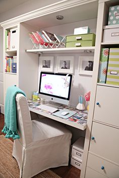 I love this work space!!! The shelf above the desktop, the desktop photos under glass, the tidy organized look!