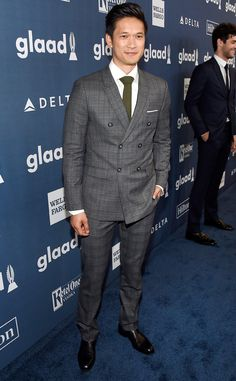 Harry Shum Jr. from GLAAD Media Awards 2016 Star Sightings  The Glee alum adds a spark of color to his suit while arriving at the Beverly Hilton Hotel.