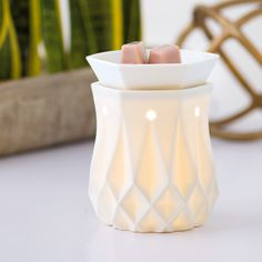 The look of chiseled alabaster — brought to life by a quiet, ethereal glow — will lend a simple sophistication to any space.  www.alexwest.scentsy.co.uk