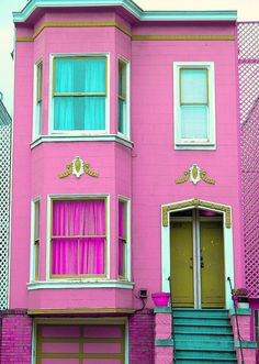 garconniere:    (image description: a digital photograph of a bright pink brick two storey house in san francisco taken by christopher lynch. it has mustard coloured doors and details around the trim, with some turquoise steps and curtains.)  this is the dream house i would buy as a wedding present for majestic legay and jessica if i had the funds to be a properly decadent sugar mama.