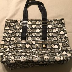 """Harajuku Lovers Large Tote Bag Black with white hearts, large tote bag. 2 front & 2 side pockets all with Velcro closing. Cream interior with black spots & snap closure. Large inner zip pocket. 17""""W x 14""""L x 6""""D Drop from top of strap is about 9"""". This bag has some signs of wearing...some fraying on the straps & some yellowing of the white, mainly near the top of bag. I'm sure a Tide pen can get it out if bothersome. Harajuku Lovers Bags Totes"""