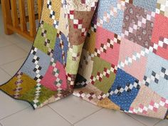 Double Four Patch Quilt by http://quiltingstories.blogspot.com/2016/02/double-four-patch-quilt-finished-civil-war-fabrics.html