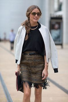 The fringe trend is going strong this season. And while suede fringe connotes a distinctly boho/western vibe, a textural mini with a swingy tasseled hem can feel surprisingly sophisticated—even casual. Make a fringe-trimmed skirt work for daytime and off-duty wear with an upscale sweatshirt, like Olivia Palermo (who we all know never looks anything less than completely put together).