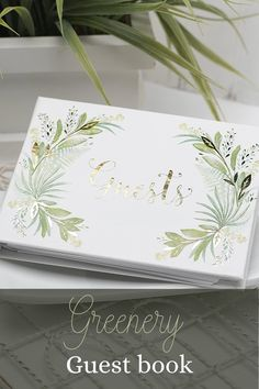 This Greenery Themed Wedding Guest book has a white vinyl cover featuring a 4-color printed design accented with gold foil. A Spiral bound guest book has a white vinyl cover with a modern style.