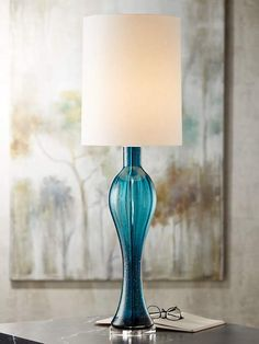 Contemporary glass table lamp with a sparkling, fluted blue art glass base.