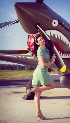 "The look of the P-40 says ""STOP TOUCHING MY PROPELLER, YOU'LL END UP STARTING MY ENGINE!"""